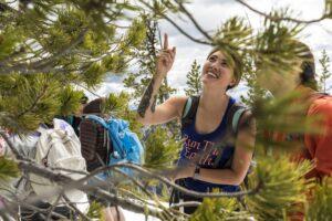 Cascades trip woman points to tree